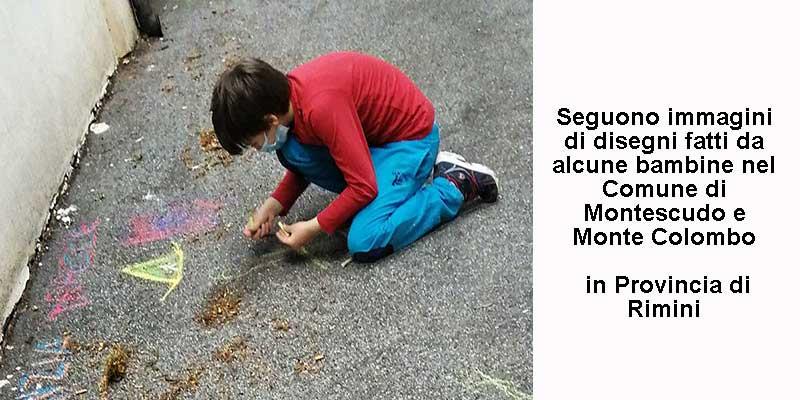 Bambino disegna sull'asfalto con gessetti colorati.